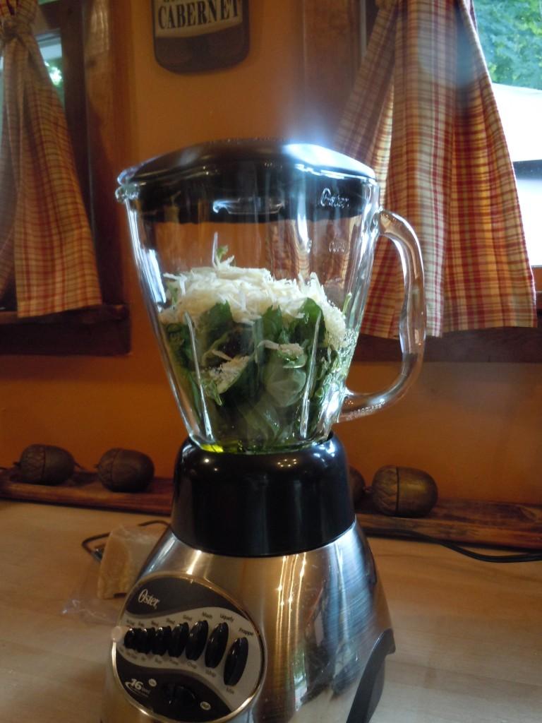 blender full of pesto ingredients