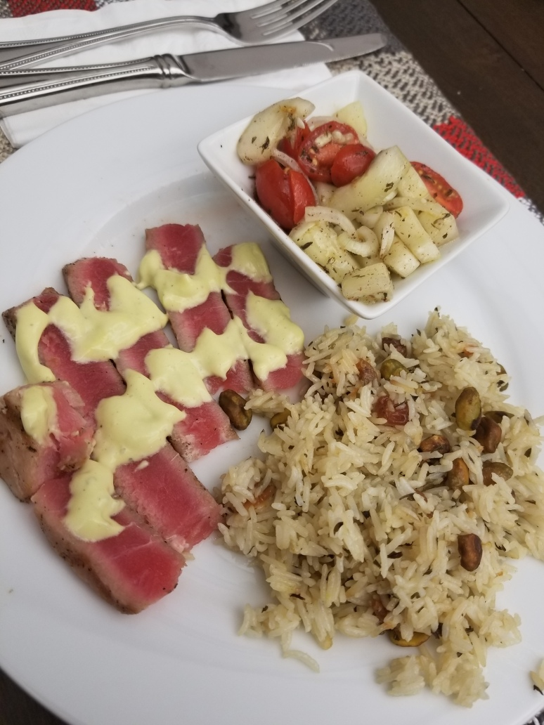 seared tuna with tarragon mayonnaise Israeli salad and raisin pistachio pilaf